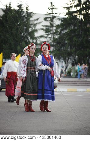 A Series Of Photographs With Ukrainian Costumes. Young Women In Ukrainian Embroidered Clothes. Holid