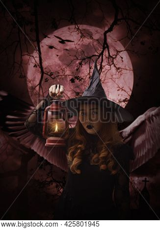 Halloween Witch With Wings Holding Ancient Lamp Standing Over Cross, Church, Crow, Birds, Dead Tree,