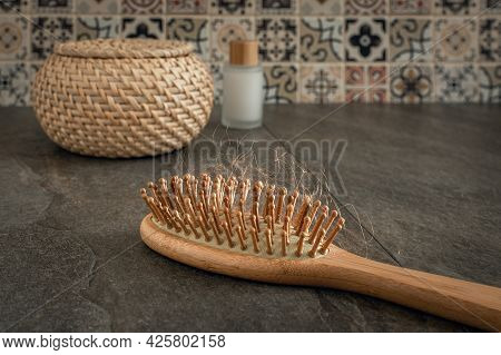 Wooden Massage Comb With Hair In The Bathroom, The Concept Of Hair Loss During Stress, Hormone Thera