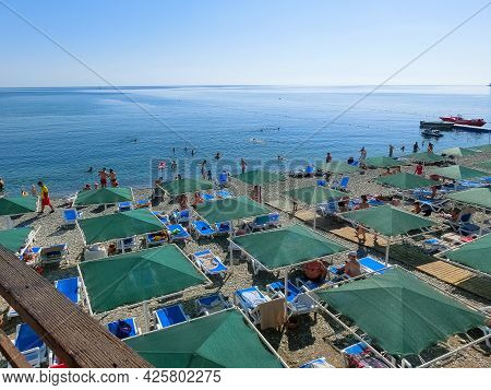 Kemer, Antalya, Turkey - May 11, 2021: Deck Chairs On The Beach With Umbrellas And Loungers With Mou