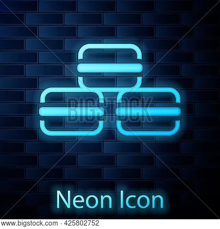 Glowing Neon Macaron Cookie Icon Isolated On Brick Wall Background. Macaroon Sweet Bakery. Vector