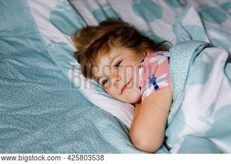 Cute Little Preschool Girl Sleeping In Bed. Adorable Baby Child Dreaming, Healthy Sleep Of Children