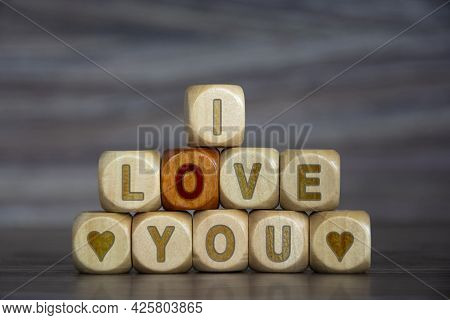 Word I Love You On Wooden Cubes On Blurred Background. Declaration Of Love. Defocusing, Concept. Alp