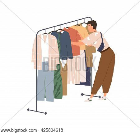 Young Woman In Modern Clothes Shopping And Looking For Fashion Outfit. Female Choosing From Trendy S