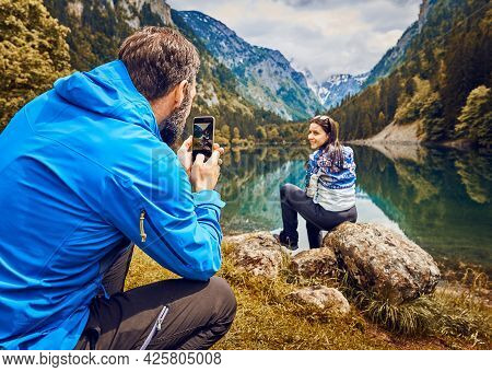 Traveling outdoor hiking and camping lifestyle in nature. Traveling outdoor hiking and camping lifestyle in nature. Traveling in nature. Couple hikers outdoor in nature.Nature lifestyle. Lifestyle camping in Nature. Hikers camping in nature. Hiking and ca