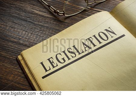 Open Book On A Page With A Topic Legislation.
