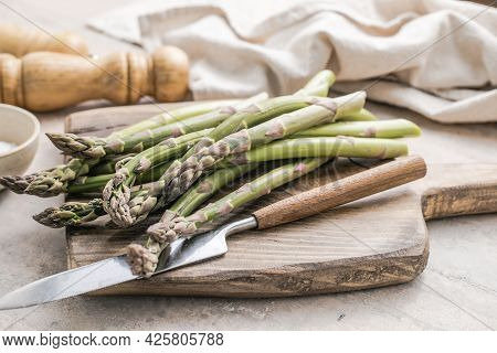 Asparagus. Asparagus Cooking Concept, Top Down View On A Cutting Board With Fresh Bunch Of Asparagus