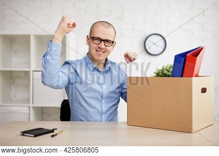 Last Day In Office - Happy Fired Man With His Belongings In Moving Box