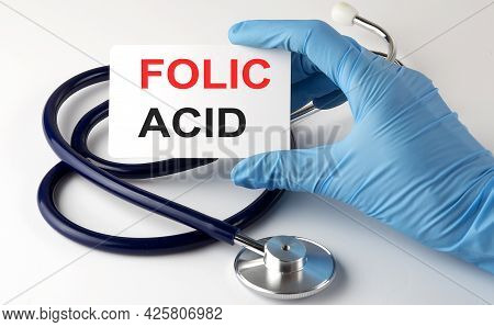 Card With Text A Folic Acid , Pills And Stethoscope. Medical Concept.