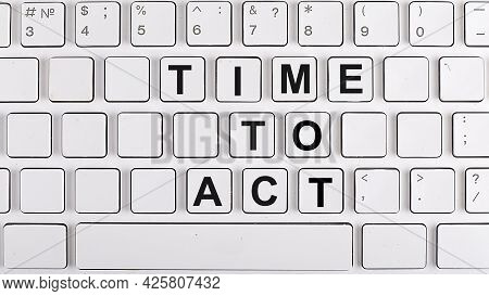 Time To Act Text On The Background Keyboard. Business Concept