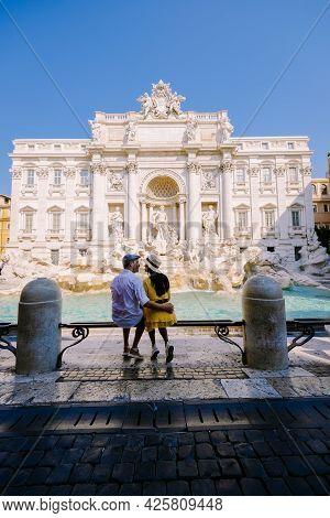 Trevi Fountain, Rome, Italy. City Trip Couple On A City Trip In Rome, View Of Di Trevi Fountain. Asi
