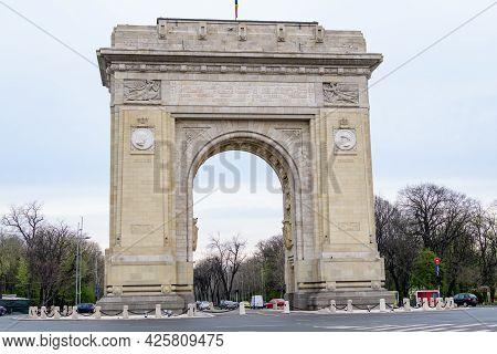 Bucharest, Romania, 17 April 2021: Arcul De Triumf (the Arch Of Triumph) Is A Triumphal Arch And Lan