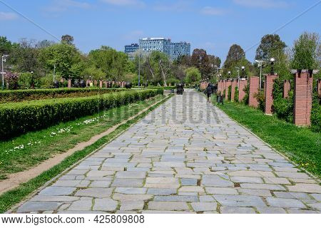 Bucharest, Romania - 30 April 2021: Landscape With The Main Alley And Many Large Green Trees In King
