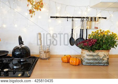 Colorful Autumn Still-life On A Kitchen Table At Home. Pumpkins, Bouquet Of Flowers And Falling Leav