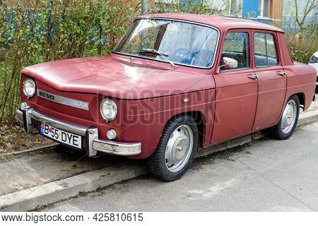 Bucharest, Romania, 19 March 2021 Old Retro Dark Red Romanian Dacia 1100 Classic Car Parked In A Str