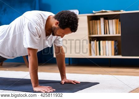 Young  African American Is Holding His Body In Yoga Position, Getting Active While Isolated During Q