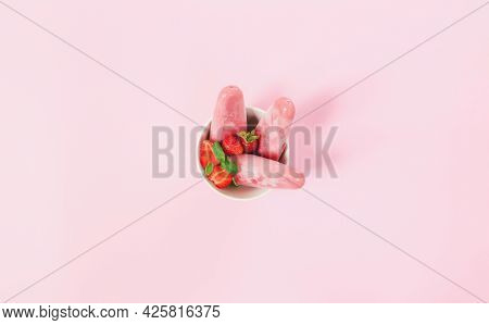 Top View On Bowl With Fruity Pink Frozen Sorbet Ice-cream On Plastic Stick With Strawberry, Mint On