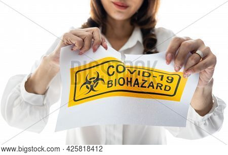 Woman Holding And Tearing Paper With Covid-19 Biohazard Words. The Idea Or Concept For Happiness And