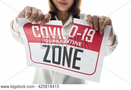 Woman Holding And Tearing Paper With Covid-19 Quarantine Zone. The Idea Or Concept For Happiness, Fr