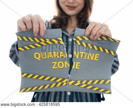 Woman Shows And Tearing Paper With Covid-19 Lockdown Quarantine Zone Words. The Idea Or Concept For