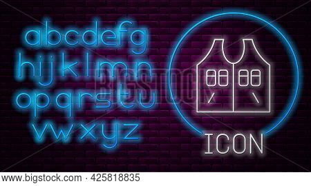 Glowing Neon Line Hunting Jacket Icon Isolated On Brick Wall Background. Hunting Vest. Neon Light Al
