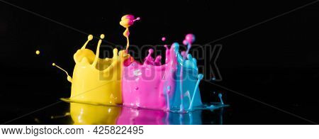 ?bstract sculptures of colorful splashes of paint. Dancing liquid on a black background. Ink water splash. Color explosion.