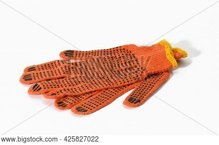 Textile Orange Work Gloves On A White Background. Protective Clothing For Manual Workers, Close Up