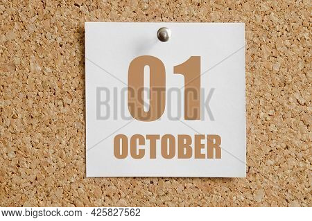 October 01. 01th Day Of The Month, Calendar Date.white Calendar Sheet Attached To Brown Cork Board.