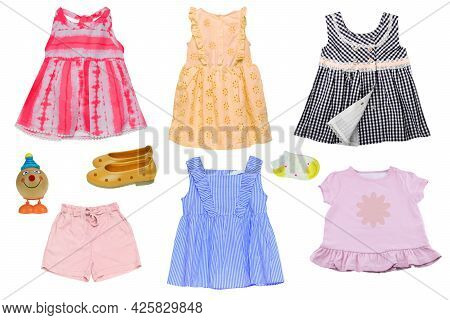 Collage Set Of Little Girl Summer Clothes Isolated On A White Background. The Collection Of Various