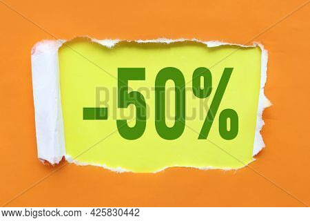 50 Percent Off. Text On White Paper Near Torn Orange Paper