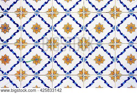 Old Tiles Wall On A Street Azulejos Ceramic Tile Work. Porto, Portugal.