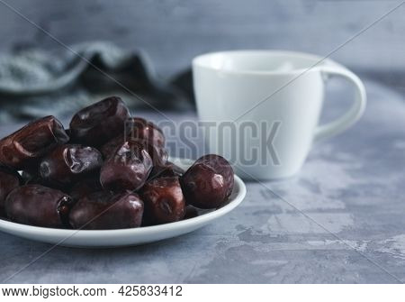 Cup Of Tea And Dried Fruits On Gray Concrete Background