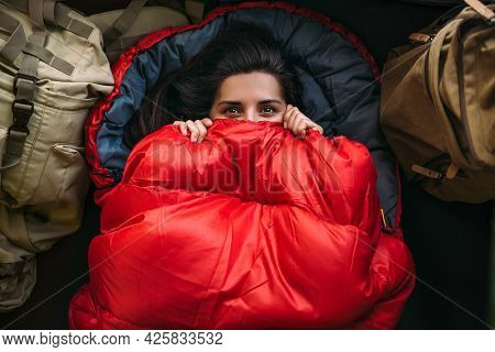 A Young Woman In A Comfortable Sleeping Bag In A Tent, Top View. A Tourist In A Sleeping Bag. A Trav