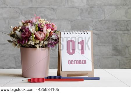 October 01. 01-th Day Of The Month, Calendar Date.a Delicate Bouquet Of Flowers In A Pink Vase, Two