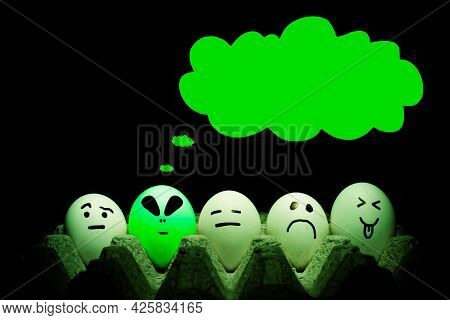 Alien Egg With Thought Cloud. Eggs In A Basket With A Green Alien Egg. Invasion Concept.