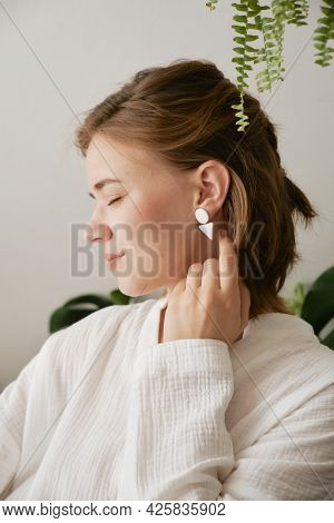 Cute Girl In White Ceramic Earrings In The Form Of Geometric Shapes. Handmade Jewelry.