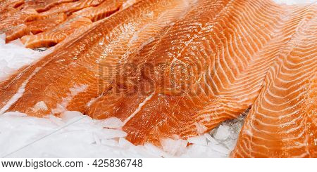 Fresh Pieces Of Red Fish On The Counter In The Store.