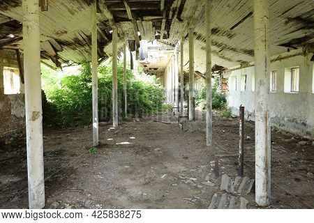 Old Ruined Room Or Farm. Building With Ruined Walls And Ceiling.