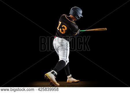 Professional Baseball Player, Pitcher In Sports Uniform And Equipment Playing Baseball Isolated On B