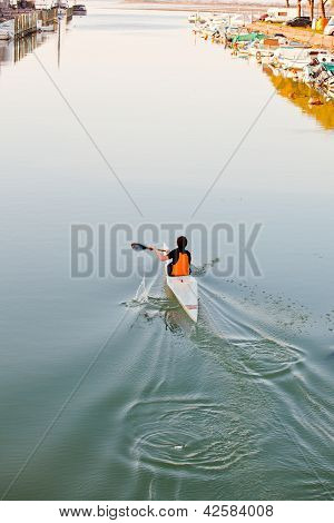 Young Athlete In A Canoe