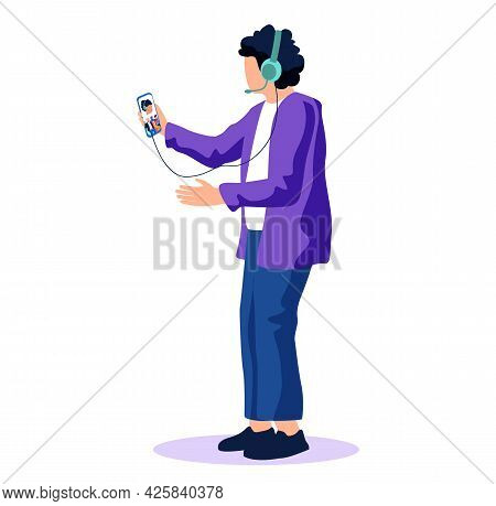 Young Man In Headphones Listening To Audio Program, Music, Podcast On Smartphone. Guy Listens To Liv