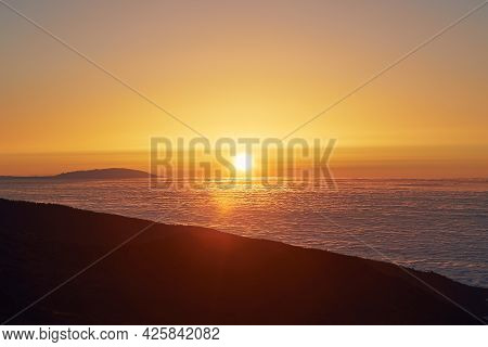 Sun Above Clouds. Mountain Landscape At Golden Sunset. Tenerife, Canary Islands, Spain.