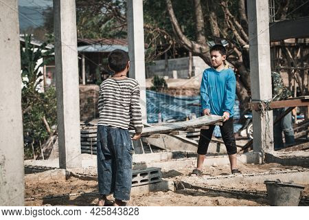 Blurred Image Of Children Working In Construction, Child Labor,  Violence Children And Trafficking C