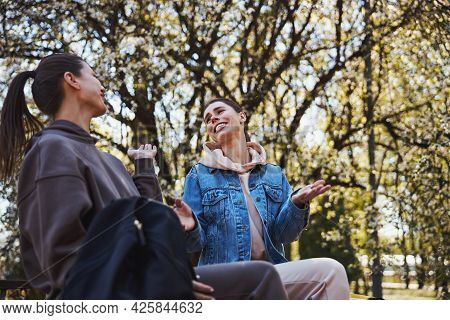 Two Female Friends Sharing Gossips With Each Other