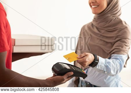 Deliveryman Holding Pos Machine, Muslim Client Paying With Card