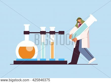 Arab Scientist Working With Test Tube Man Researcher Making Chemical Experiment In Laboratory Molecu