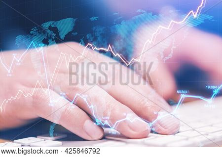 Side View And Close Up Of Hands Using Computer Keyboard On Desktop With Abstract Forex Chart. Fintec