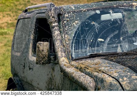 A Dirty Car Covered With A Layer Of Swamp Spray As A Result Of Off-road Driving In Sunny Weather, Wi