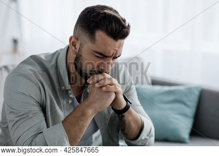 Unhappy Depressed Caucasian Handsome Bearded Man Crying In Living Room Couch, Feeling Desperate