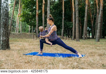 Mom And Baby Yoga Outdoor Classes. Wellness, Family Yoga Class, Practicing Mindfulness And Meditatio